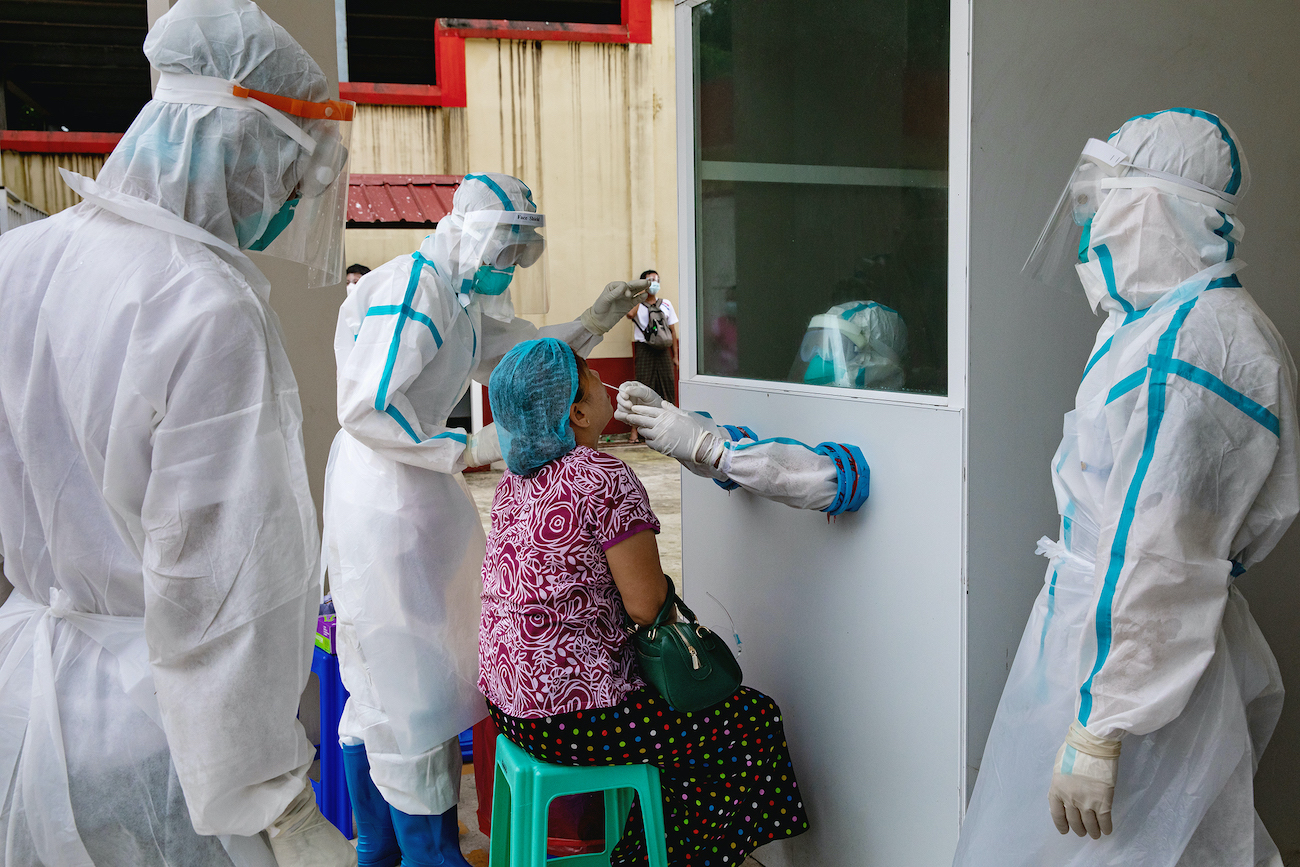 Medical workers take a swab sample from a patient with COVID-19-like symptoms at the Insein Fever Clinic on October. (Hkun Lat I Frontier)