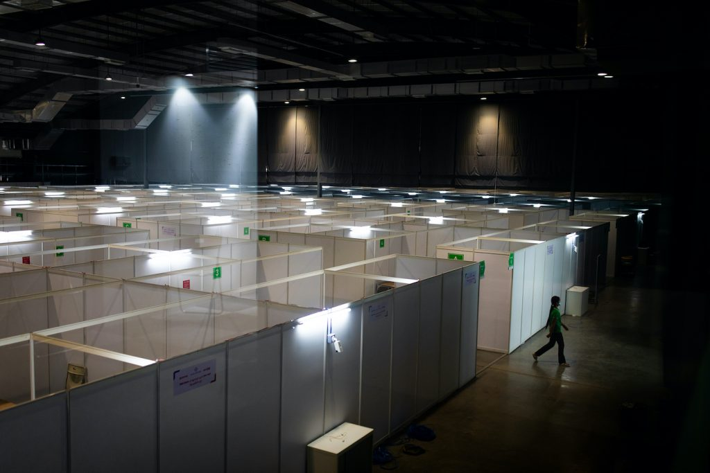 A worker exits a new, 500-capacity COVID-19 treatment centere at yjr Yangon Convention Center on October 7. (Hkun Lat | Frontier)