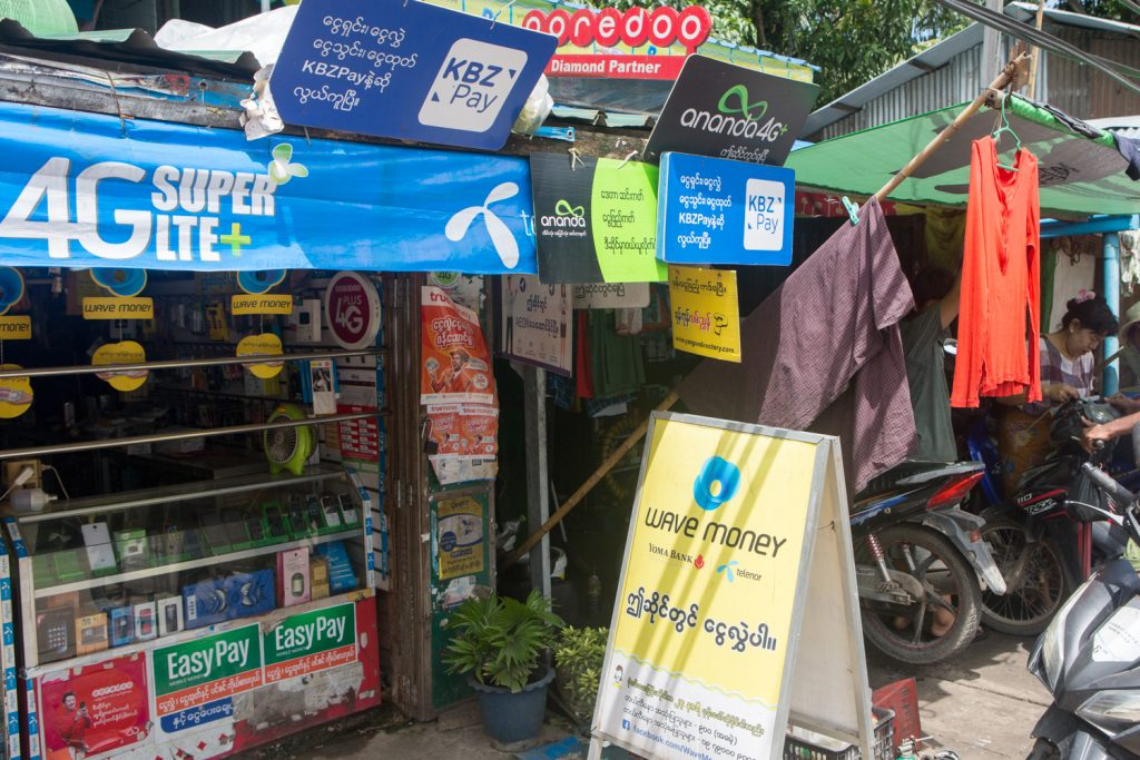 Mobile money customers in Myanmar have been spoilt for choice, with five licensed non-bank operators and numerous apps linked to private banks. (Thuya Zaw | Frontier)