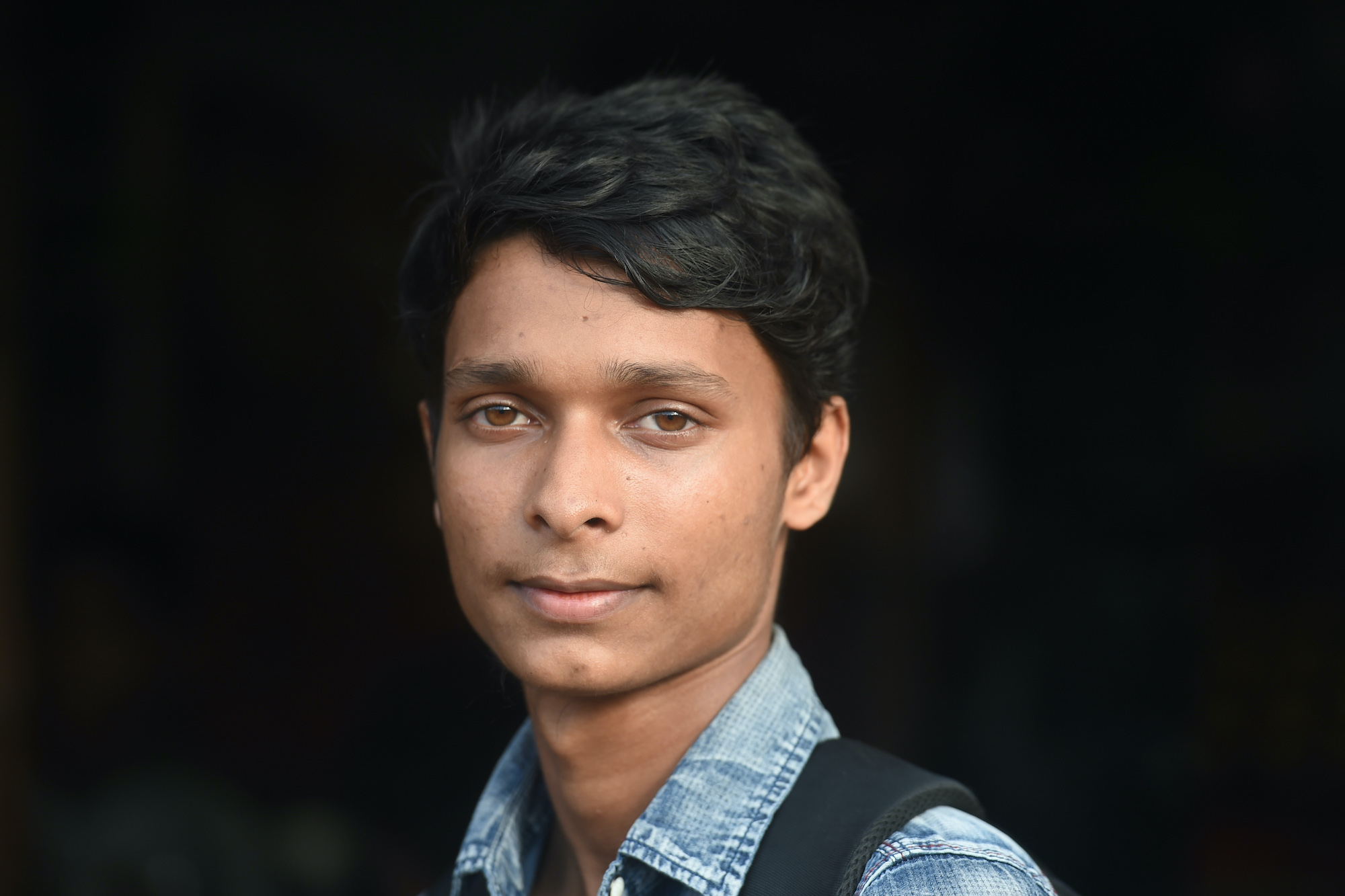 Rohingya refugee Sawyed Ullah, 18 – seen here posing for a photo near his home in the Jamtoli refugee camp, near Ukhia, Bangladesh, on August 23 – fled military-backed violence in Myanmar in 2017. Five million young voters will cast their first ever ballots on Sunday, though Ullah, trapped in exile, will not be among them. (AFP)