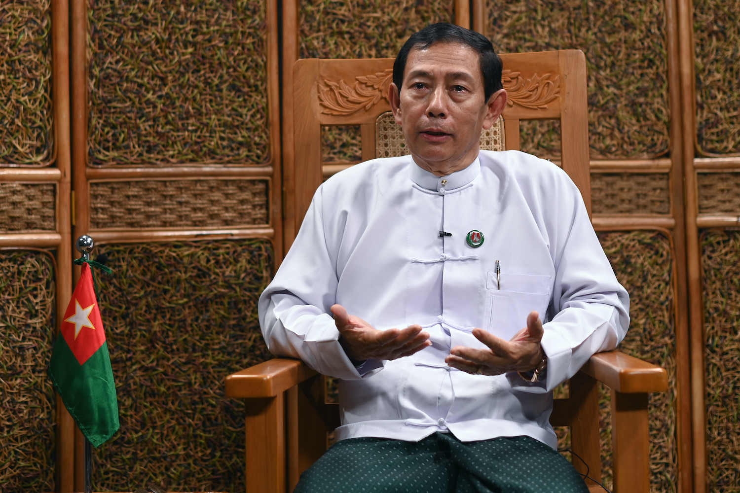 Union Solidarity and Development Party chairperson U Than Htay, seen here speaking to journalists at the party's sprawling Nay Pyi Taw headquarters on August 27, called members of the stateless and persecuted Rohingya minority