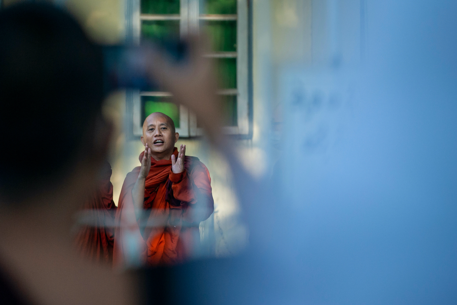 Buddhist monk Wirathu speaks to his followers before turning himself in at a Yangon police station on November 2. (AFP)