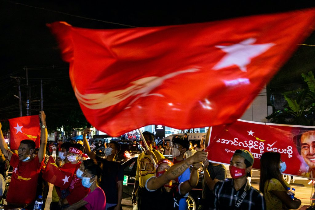 NLD supporters celebrate the party's electoral landslide in front of the party's Yangon headquarters November. (Hkun Lat | Frontier)