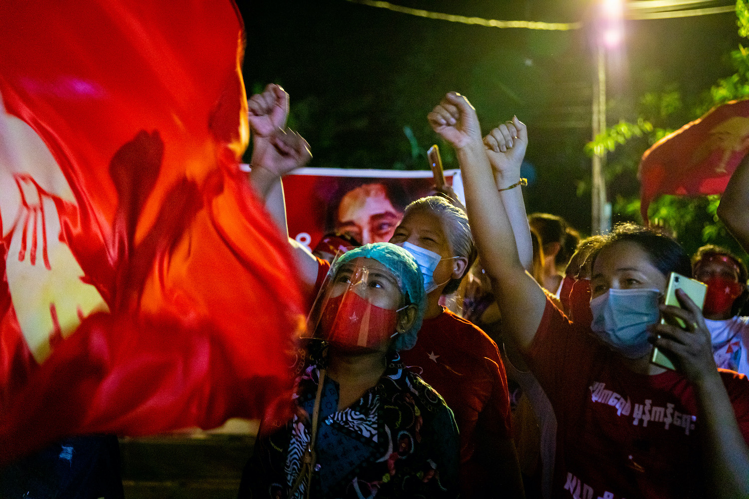 National League for Democracy supporters celebrate in front of the party's head office in Yangon on election night. (Hkun Lat | Frontier)
