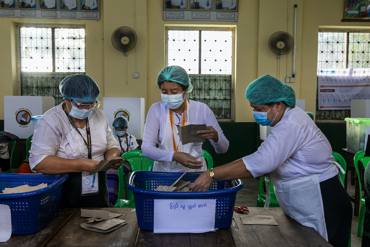 Union Election Commission officials prepare to count advance ballots at the No 5 polling station in Yangon's Mingalar Taung Nyunt Township on November 8. (Hkun Lat | Frontier)
