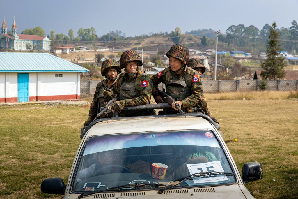 Tatmadaw soldiers in a car during a military-arranged trip in March to show off seized drugs in Lwe Kham village, Kutkai Township, northern Shan State. (Hkun Lat | Frontier)