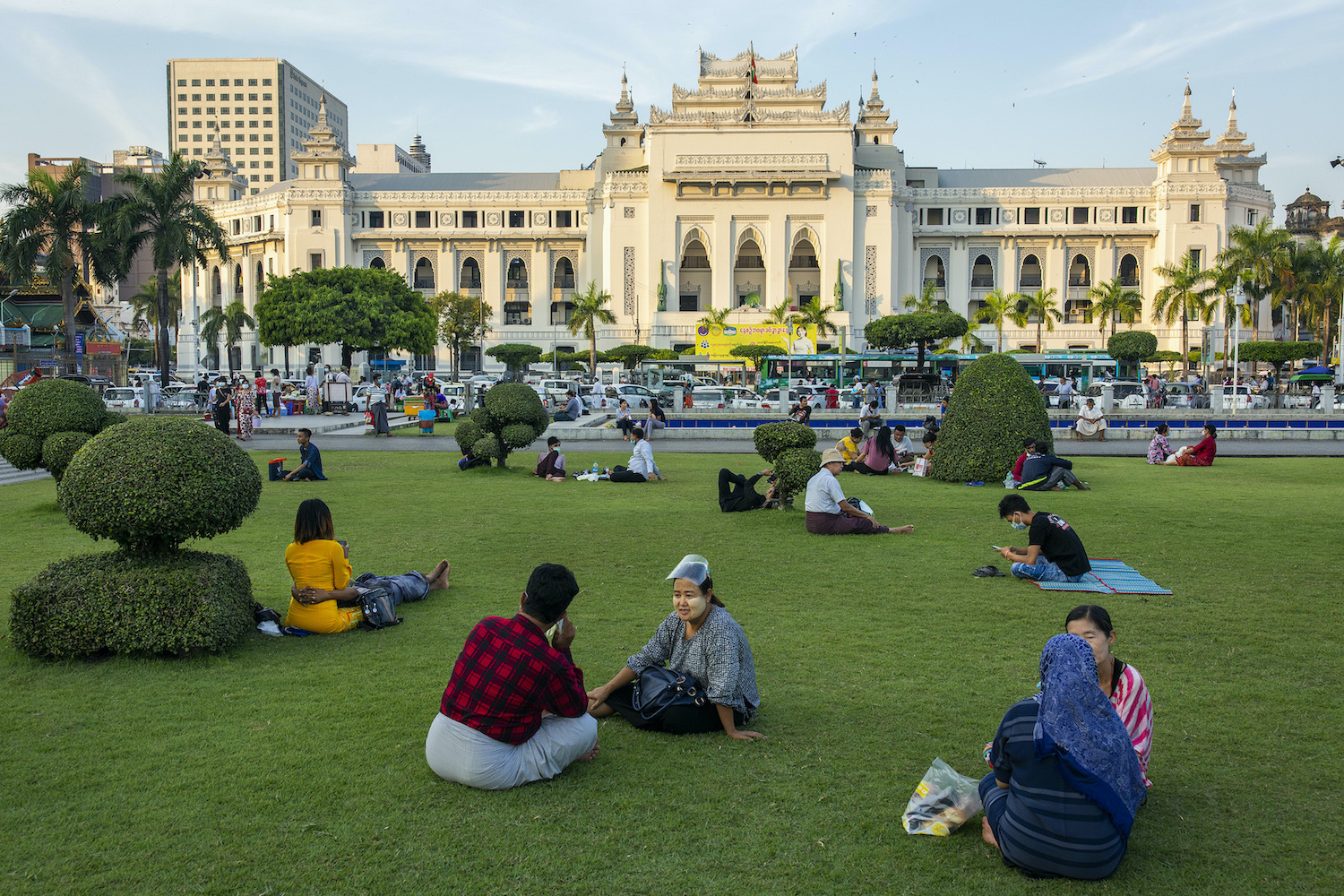 People congregate in downtown Yangon's Maha Bandoola Park on November 23, before the park was indefinitely closed. Outdoor spaces like parks offer relatively low-risk respites from stay-at-home orders, and can be a key public health tool, according to UN Habitat. (Hkun Lat | Frontier)