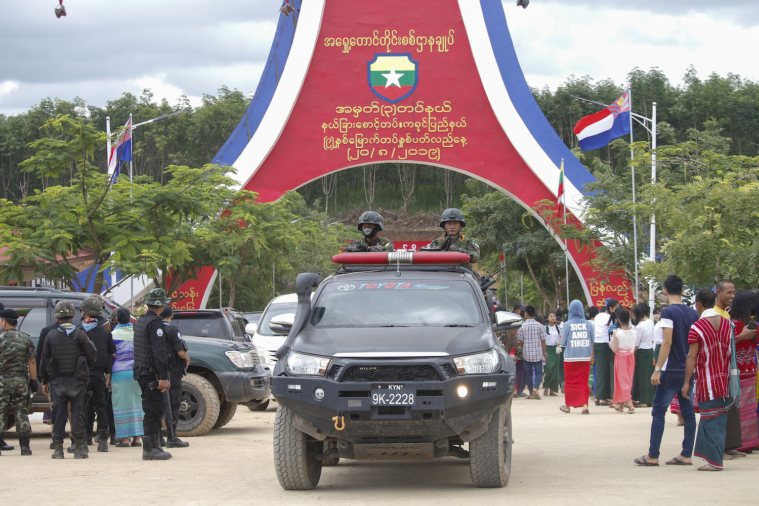 A car carrying Kayin State Border Guard Force soldiers passes under an archway at the parade ground in Shwe Kokko, Myawaddy Township, Kayin State in August 2019, when the group was celebrating its ninth anniversary. (Nyein Su Wai Kyaw Soe | Frontier)