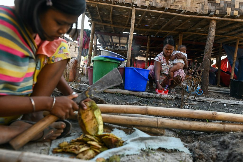 Chin people who fled conflict in southern Chin and northern Rakhine states prepare food in Bethel village, their new home in Yangon Region's Hmawbi Township, on January 11. (AFP)