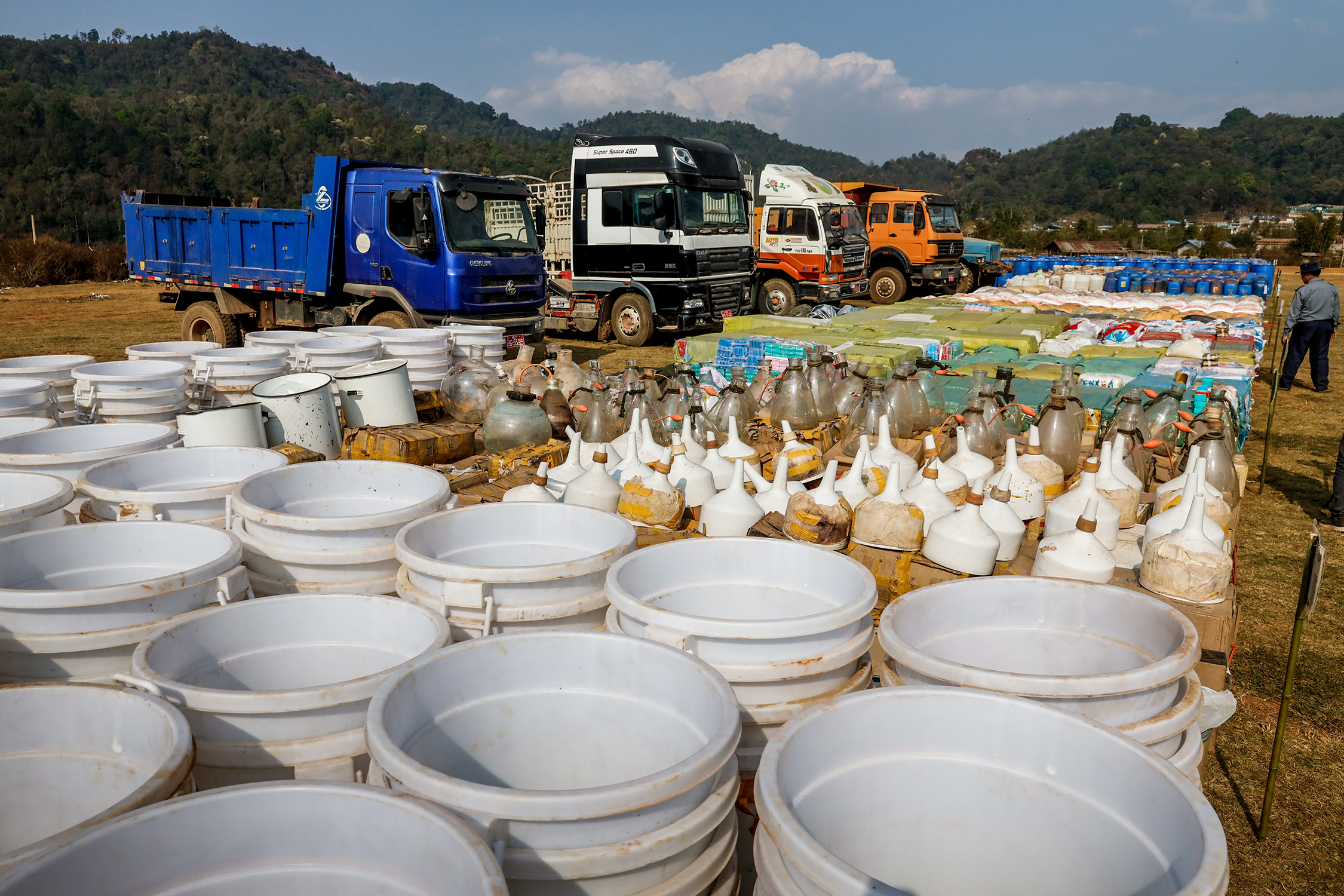 Drugs including crystal methamphetamine, yaba and heroin seized in raids in the Kawng Hkar area of northern Shan State are put on display together with vehicles, laboratory equipment and precursor chemicals at a government-organised event in Loi Kham village on March 6, 2020. (Hkun Lat | Frontier)