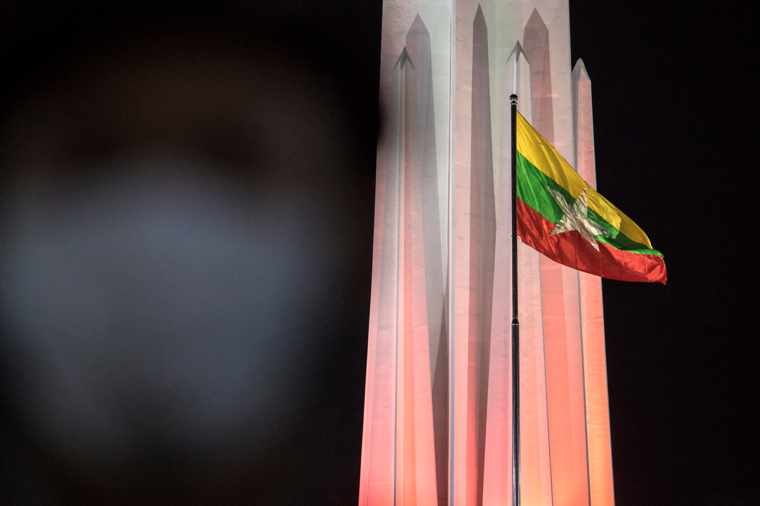 The national flag flutters during a ceremony to mark Myanmar's 73rd Independence Day in Yangon on January 4. (AFP)