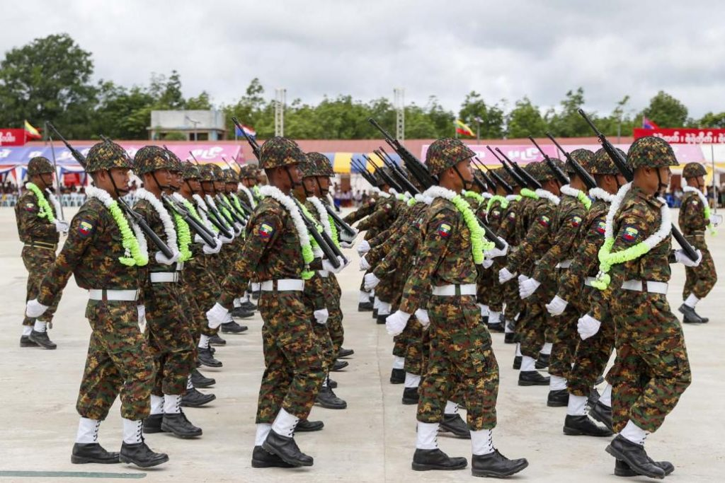 Kayin State Border Guard Force soldiers march during a parade to mark the group's ninth anniversary in August 2019. (Nyein Su Wai Kyaw Soe | Frontier)