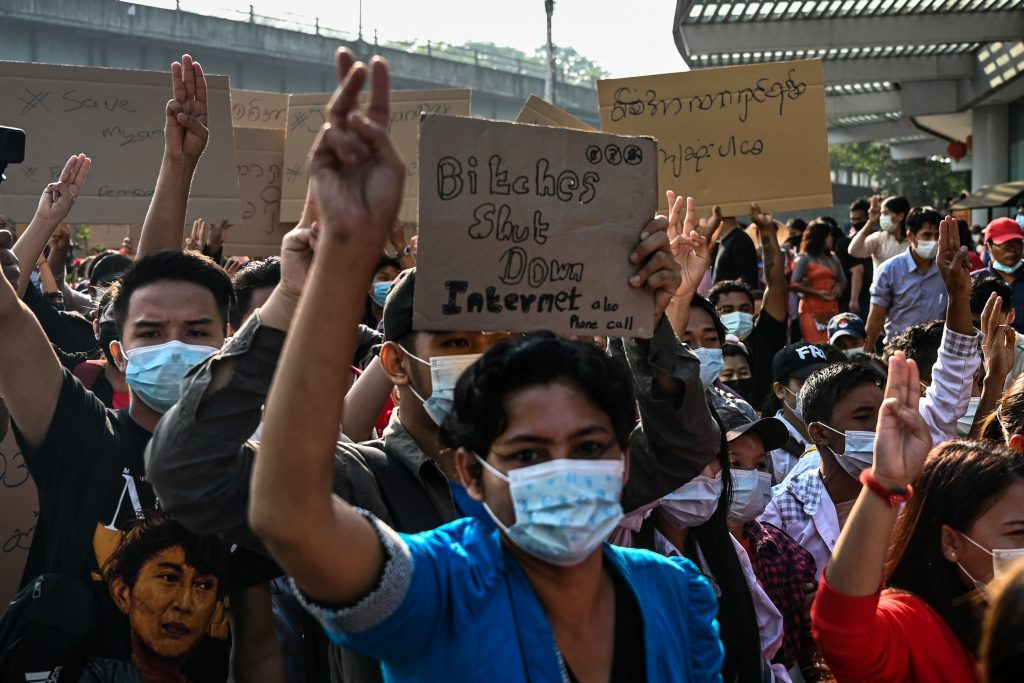 Protesters in Yangon hold placards denouncing the military's shutdown of the internet following the February 1 military coup. (AFP)