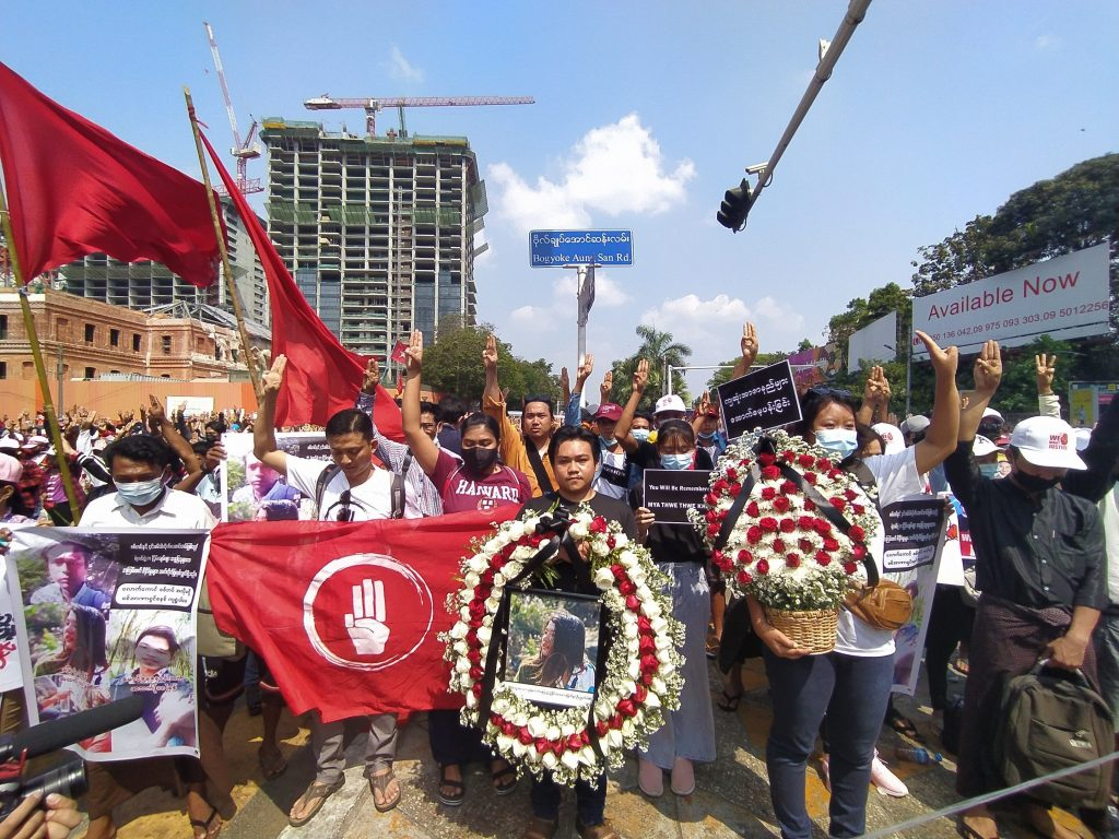 Protesters hold a memorial service for Ma Mya Thwet Thwet Khine in downtown Yangon this morning. (Frontier)