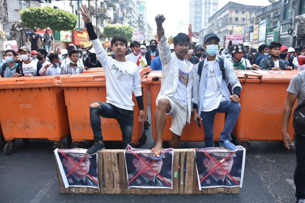 Protesters set up a makeshift barricade of wheelie bins in downtown Yangon on February 28. (Frontier)