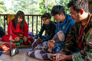 Villagers in eastern Bago Region listen to news of the February 1 coup over a radio, after the junta seized power and cut internet access across the country. (Frontier)
