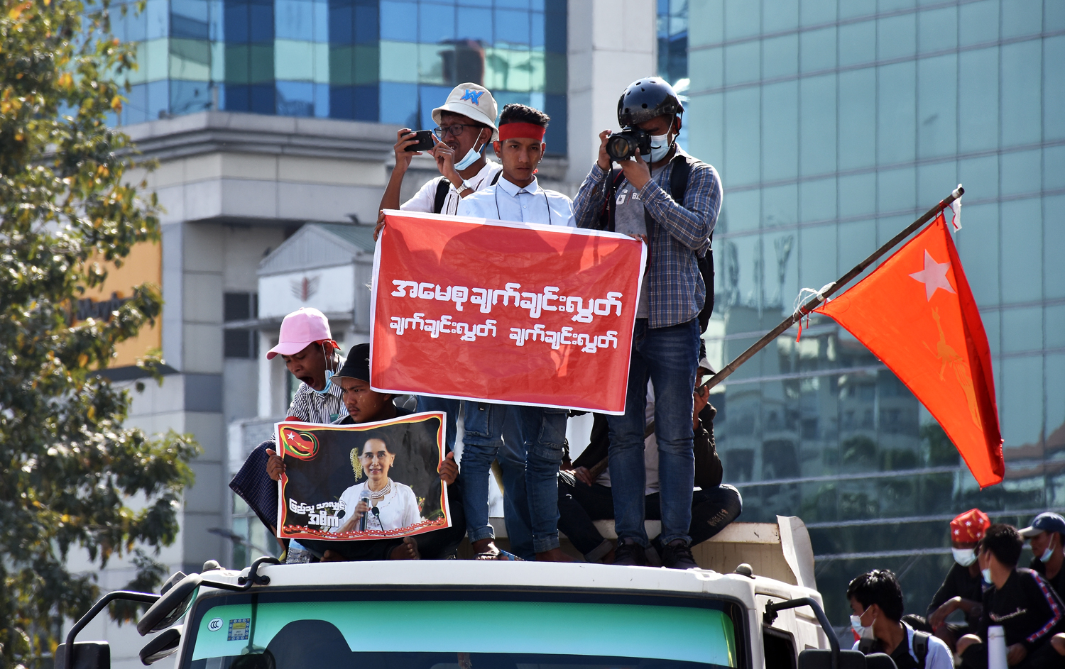 Photojournalists cover anti-coup protests in downtown Yangon on February 10. (Steve Tickner)