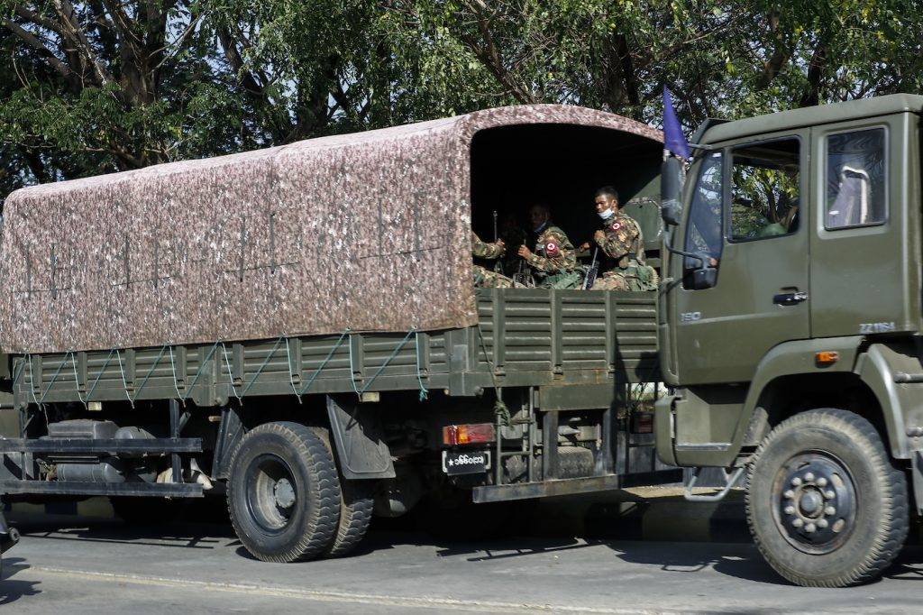 A military truck full of soldiers patrols the entrance to the municipal guesthouse in Nay Pyi Taw where MPs are staying at around 3:30pm on February 1. (Nyein Su Wai Kyaw Soe | Frontier)