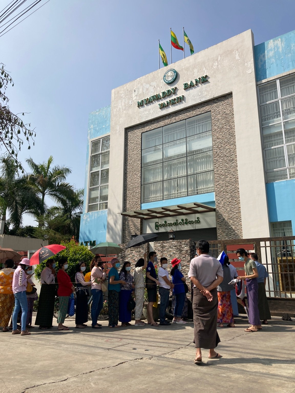 Customers queue outside of a branch of the military-run Myawaddy Bank in Yangon's Yankin Township on February 16. (Frontier)