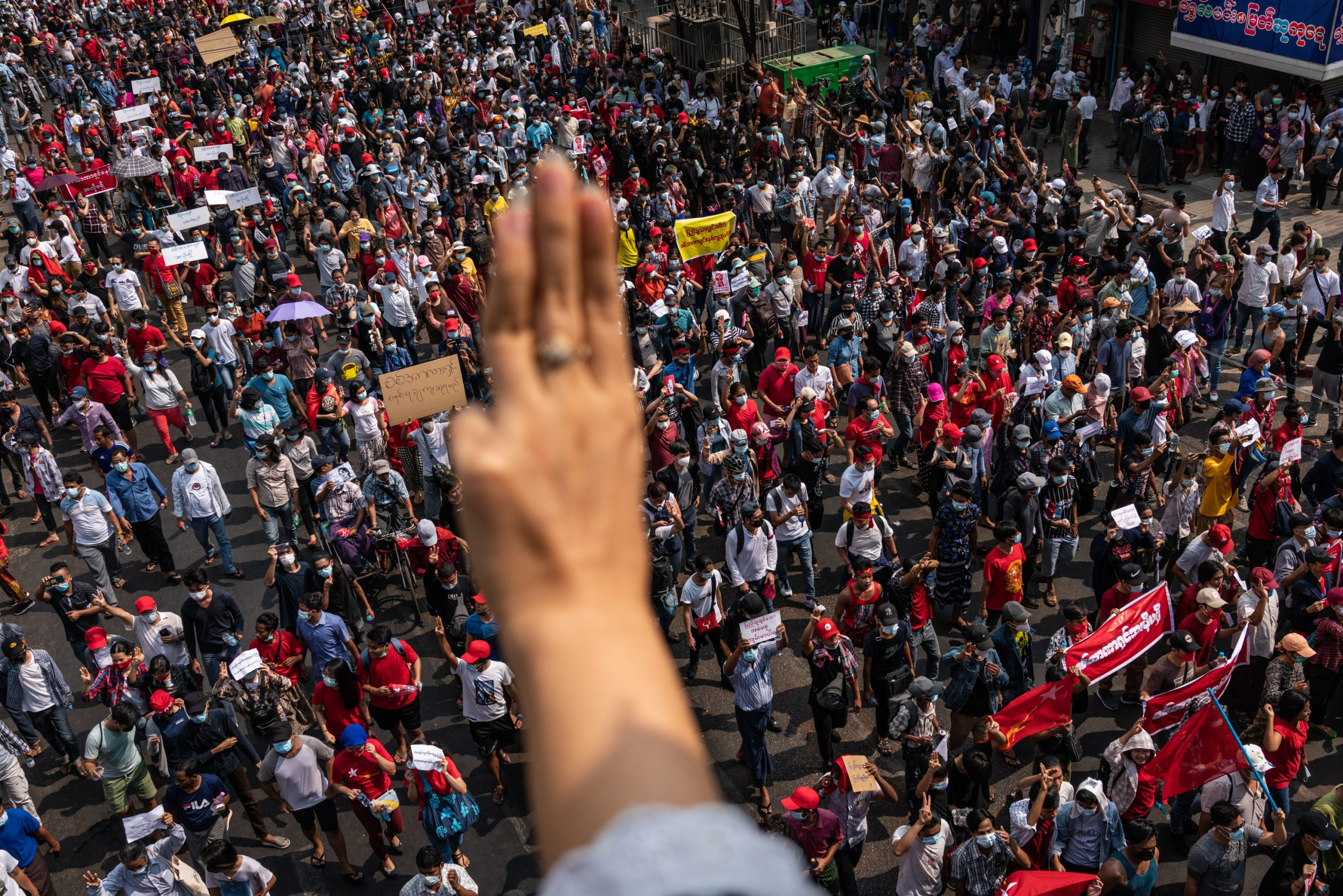 A man gives the three-finger salute to thousands of demonstrators in downtown Yangon on February 7. (Frontier)