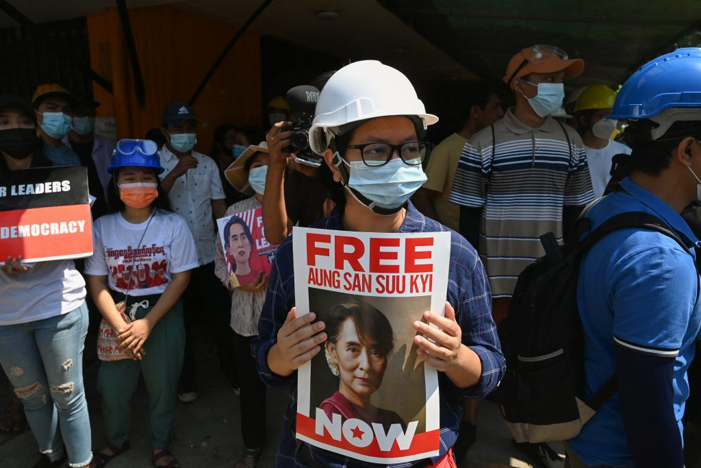 A protester holds a sign calling for the release of detained Myanmar civilian leader Aung San Suu Kyi during a demonstration against the military coup in Yangon on March 7. (AFP)