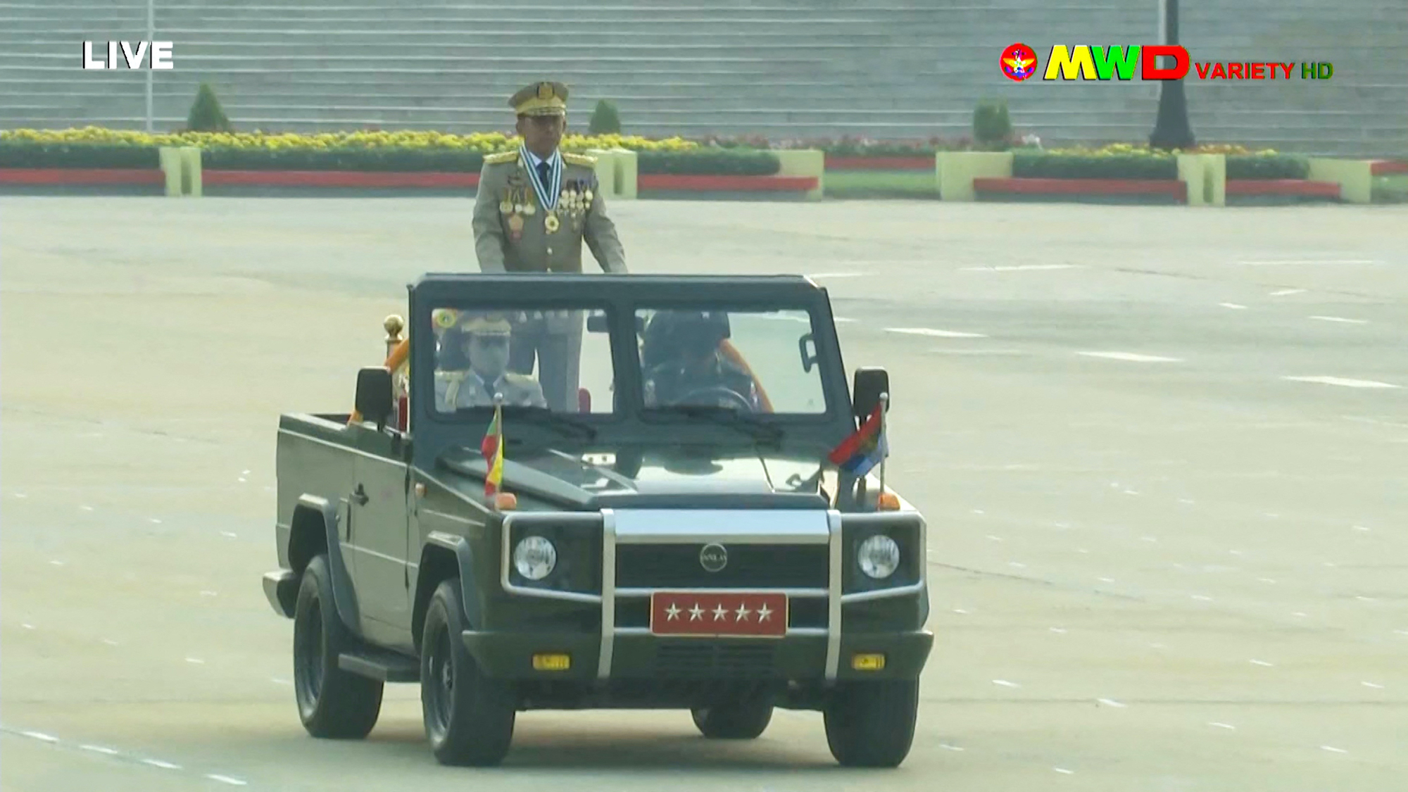 This screengrab provided via AFPTV and taken from a broadcast by Myawaddy TV on March 27 shows Tatmadaw chief Senior General Min Aung Hlaing attending an annual Armed Forces Day parade in Nay Pyi Taw. (AFP/Myawaddy TV)
