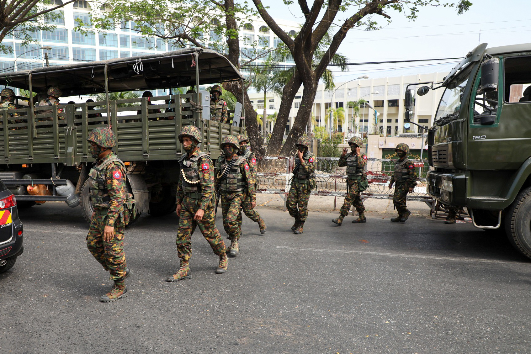 Soldiers from the 77th Light Infantry Division outside the Central Bank of Myanmar on February 15. (Frontier)