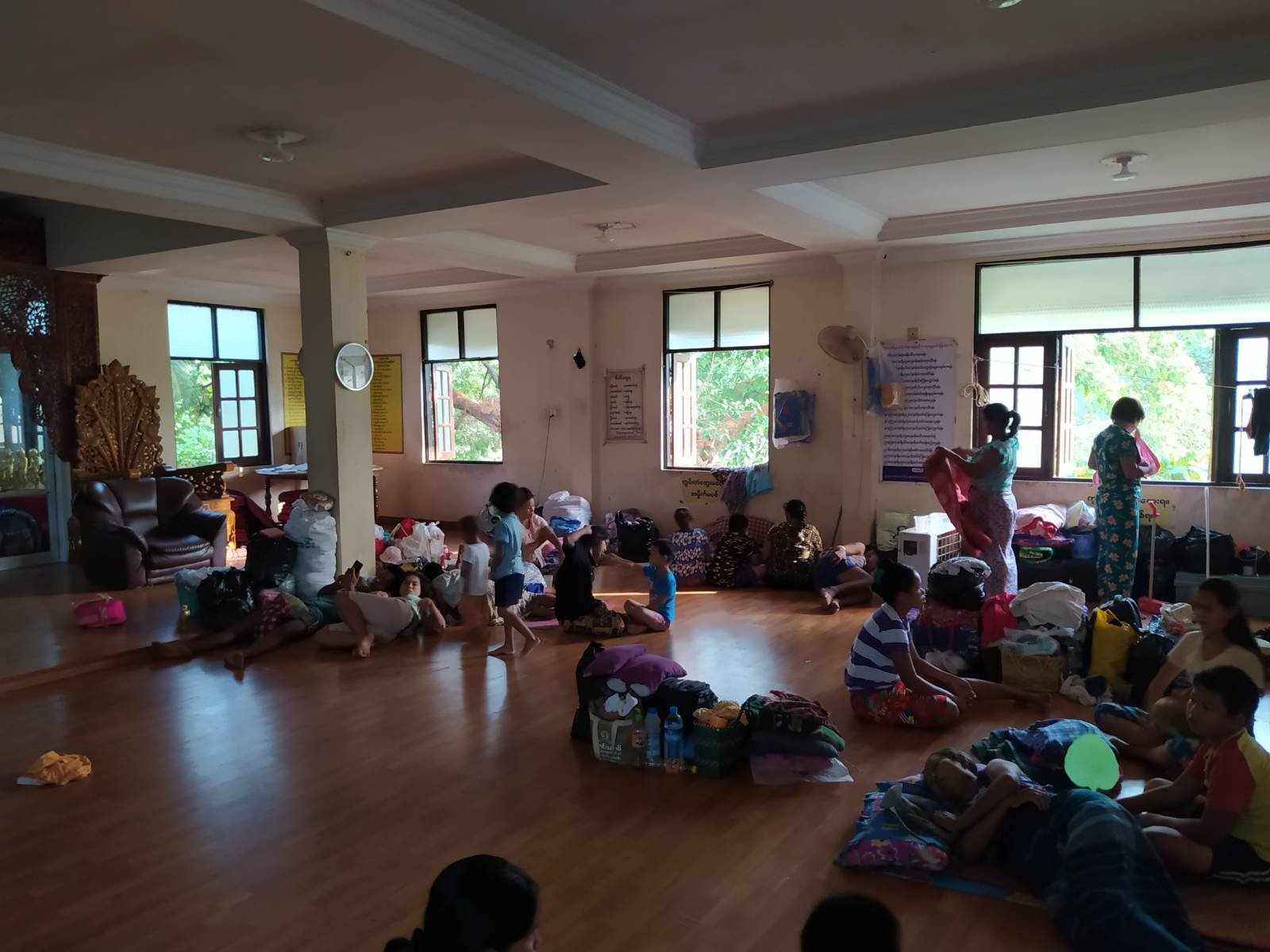 Families evicted by the military from a Myanma Railways staff housing complex in Yangon shelter at a nearby monastery on March 16. (Frontier)