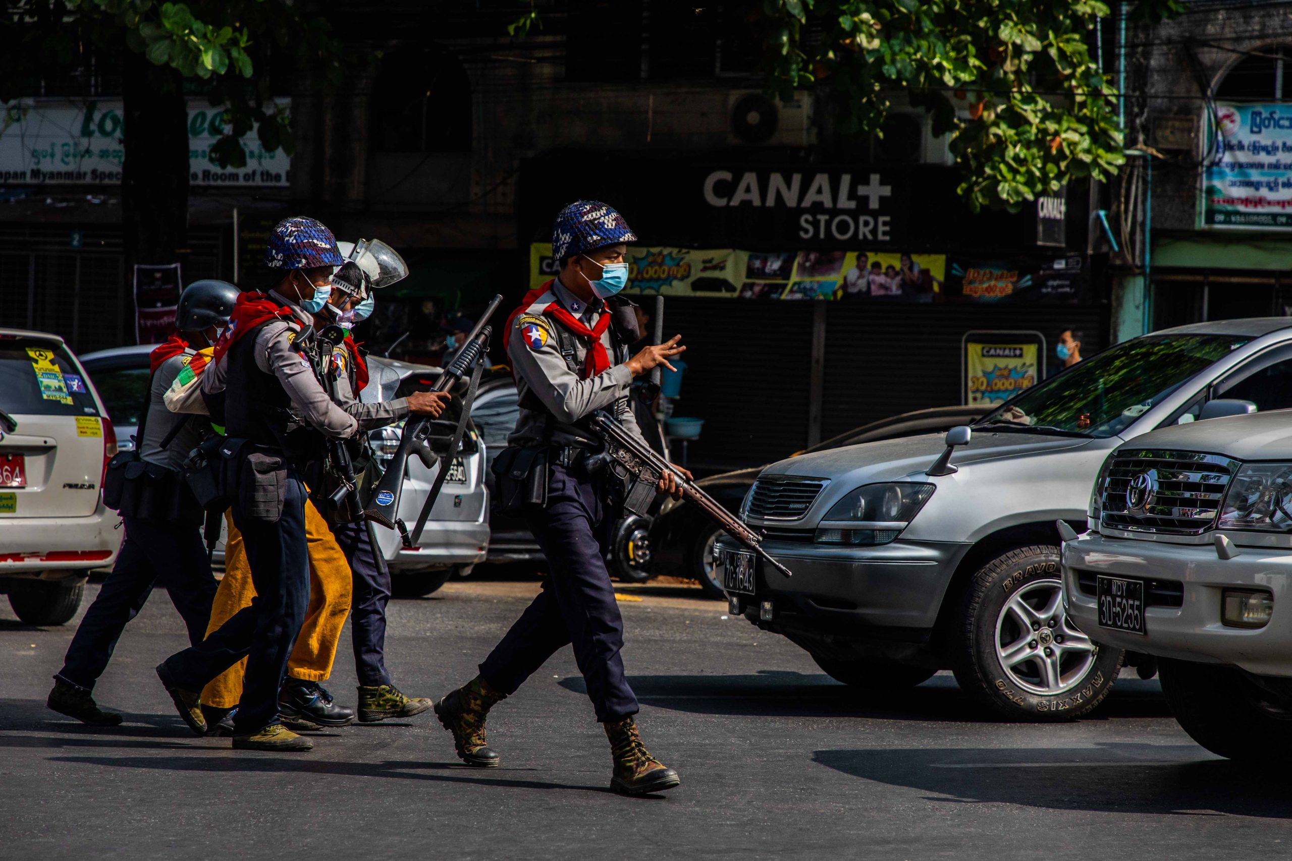 Armed police arrest a protester at an anti-coup demonstration in Yangon's Sanchaung Township on February 27. (Frontier)