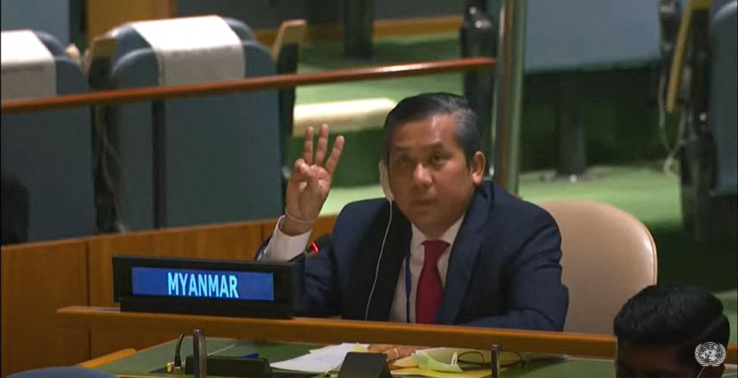 Myanmar's ambassador to the United Nations U Kyaw Moe Tun gives the three-finger salute while addressing an informal meeting of the UN General Assembly on February 26. (AFP / UN)