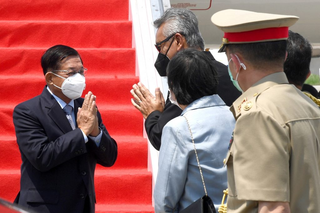 Senior General Min Aung Hlaing (L) is greeted on his arrival at Jakarta's Soekarno-Hatta international airport on April 24 to attend a Association of Southeast Asian Nations summit on the Myanmar crisis. (Indonesian Presidential Palace / AFP)