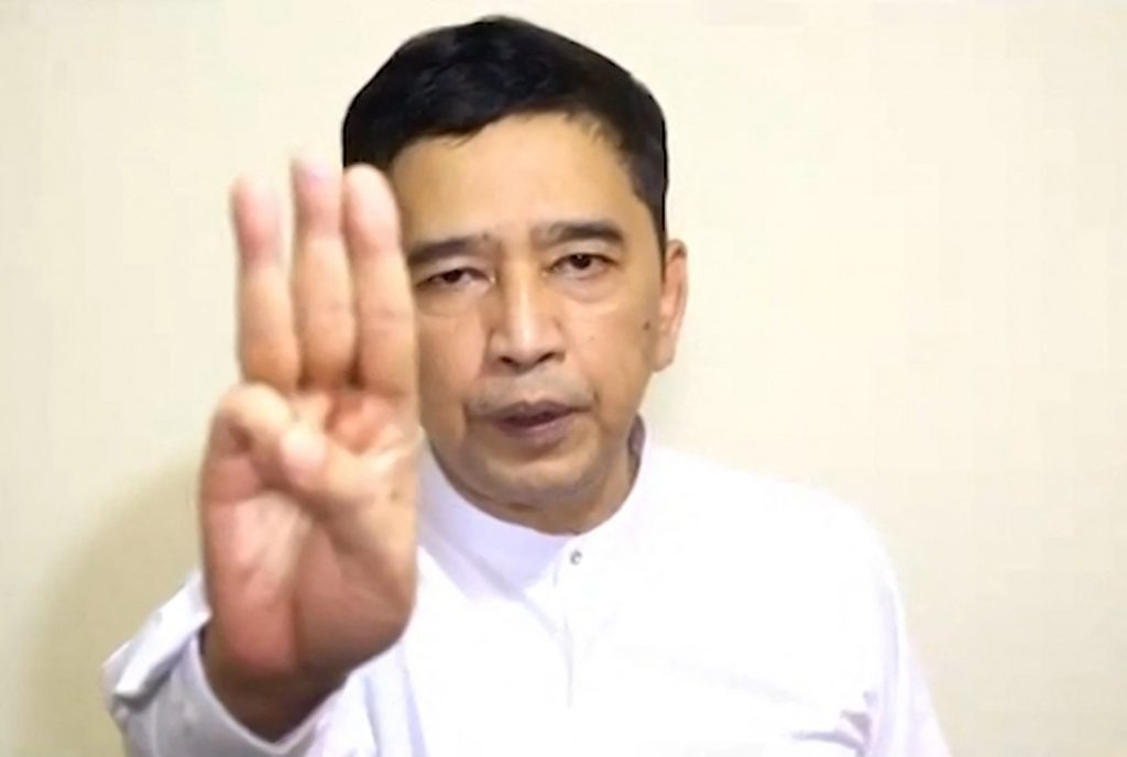 Activist Min Ko Naing holds up the three-finger salute while announcing the formation of a new National Unity Government from an undisclosed location in a video released by the Committee Representing the Pyidaungsu Hluttaw on April 16. (CRPH / AFP)