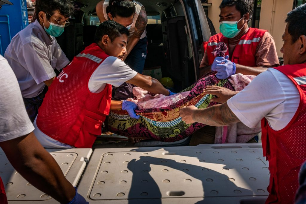 Volunteer medics carry the body of a protester killed by security forces during a crackdown on a demonstration in Yangon on March 27. (Frontier)