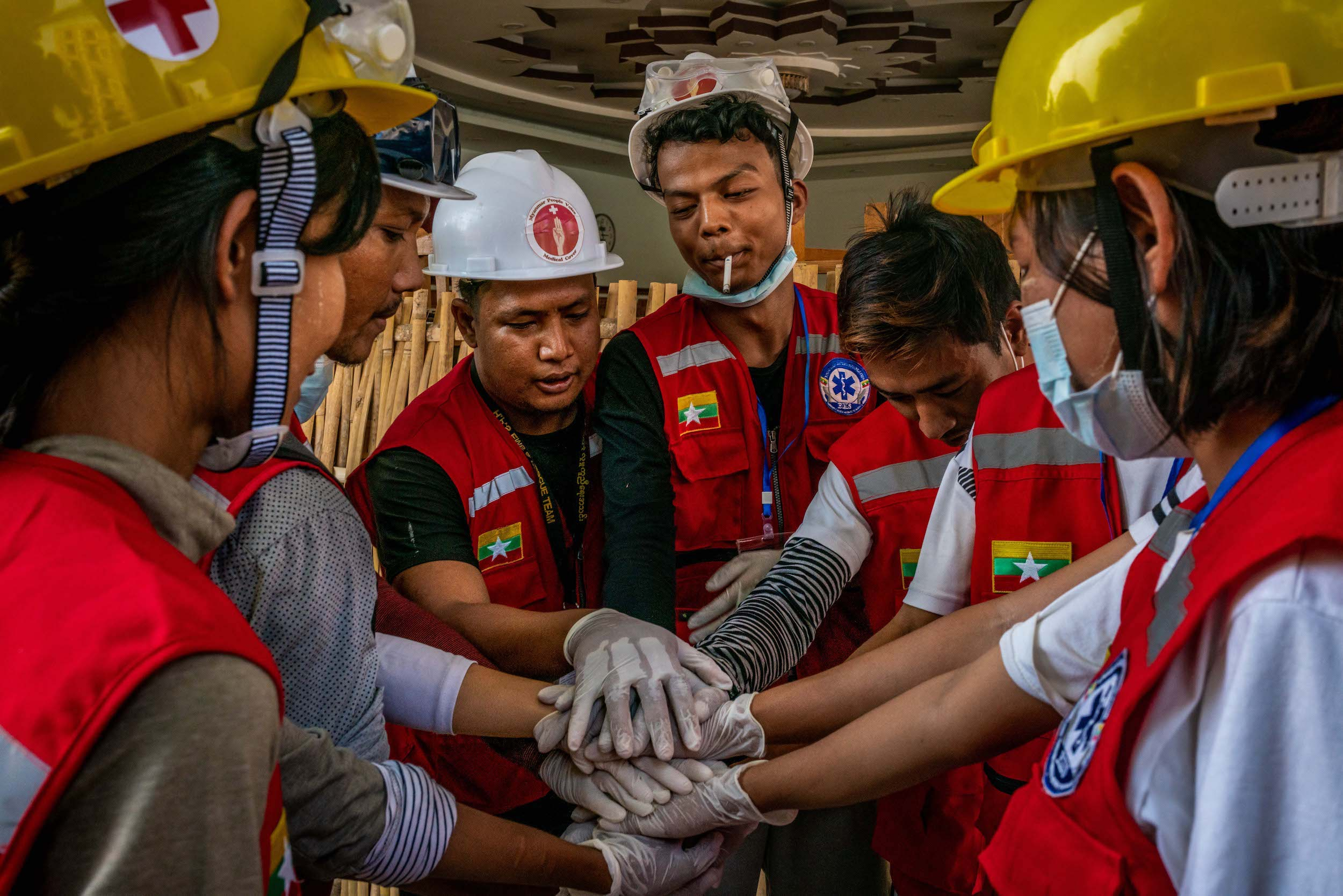 Volunteer rescue workers huddle on the morning of March 3 before working a protest in Yangon's Sanchaung Township. (Frontier)
