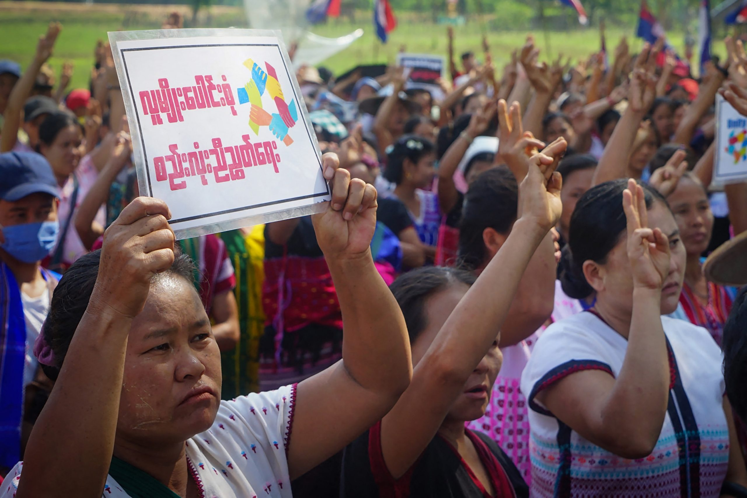 Protesters raise the three-finger salute during a demonstration against the military coup in an area under the control of the Karen National Union in Kayin State on April 22. (AFP / KNU DOOPLAYA DISTRICT)