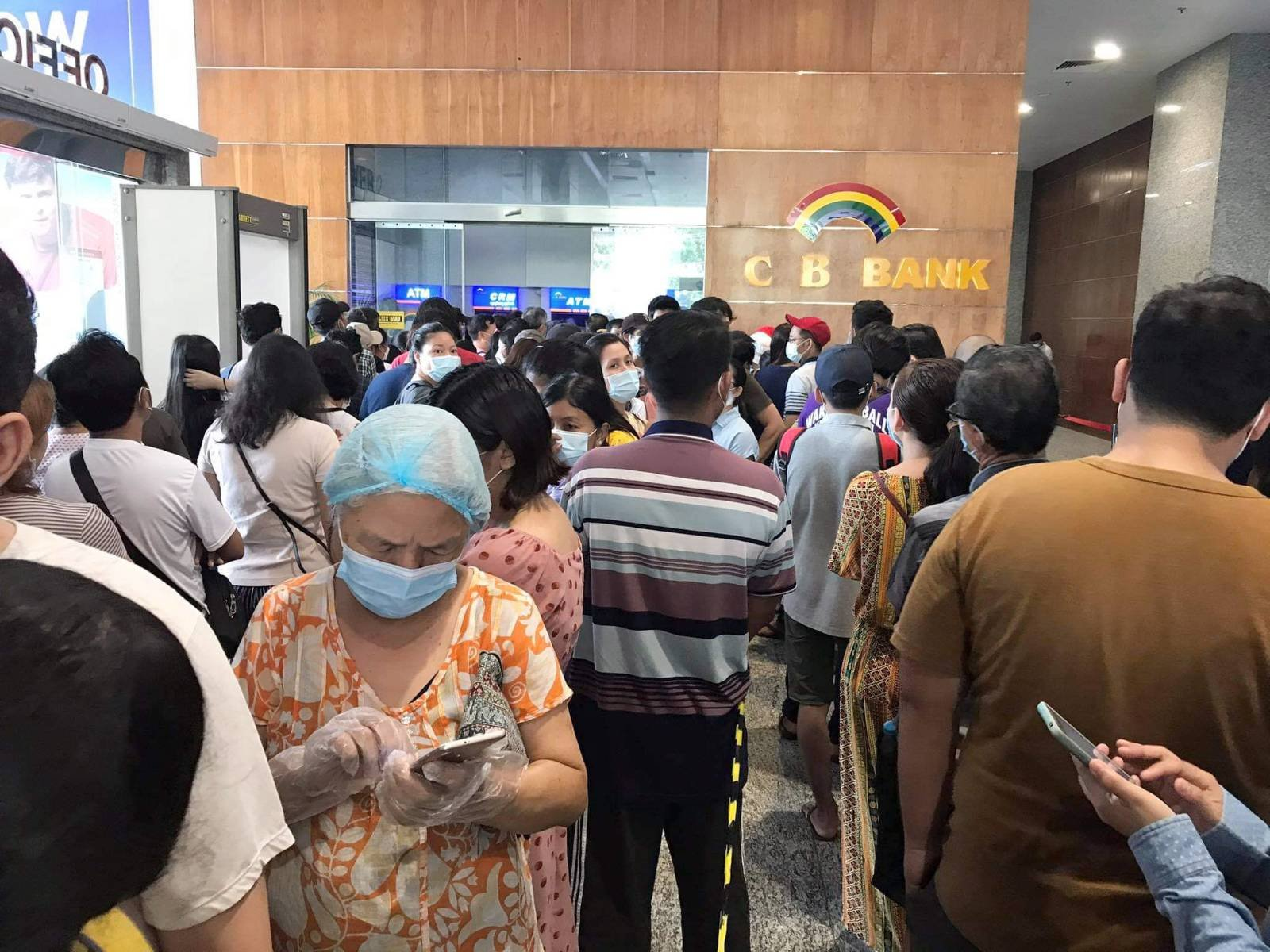 Customers line up to withdraw cash from CB Bank ATMs in Yangon on May 5. (Frontier)