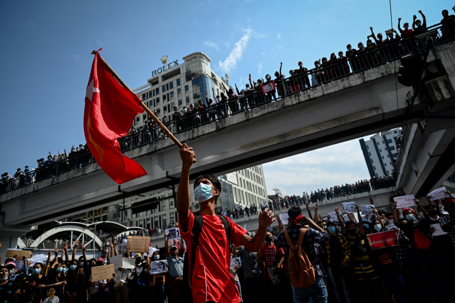 An anti-coup demonstration in downtown Yangon on February 8. Due to bloody crackdowns by security forces, the mass street protests of February have given way to flash-mob demonstrations in cities and towns and guerrilla conflict in the countryside. (AFP)