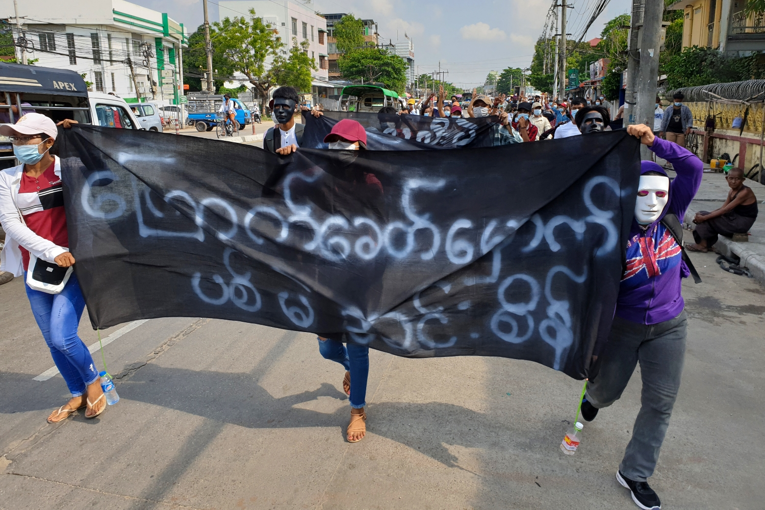 Anti-coup protesters march in northern Yangon's Insein Township on May 1. (AFP)