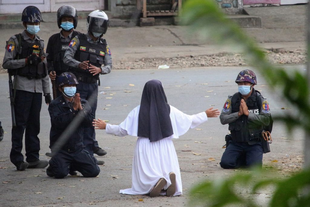 Christian nun Sister Ann Rose Nu Tawng pleads with police not to harm protesters amid a crackdown on an anti-coup demonstration in the Kachin State capital Myitkyina on March 8. (Myitkyina News Journal / AFP)