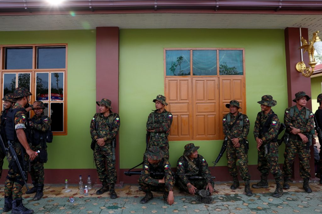 Karen BGF soldiers at ease on the sidelines of the group's ninth anniversary ceremony in Shwe Kokko on August 20, 2019. (Frontier)