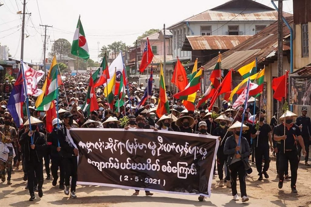 "Protesters in Kyaukme, northern Shan State march for ""Global Myanmar Spring Revolution Day"" on May 2. (Shwe Phee Myay News Agency /AFP)"