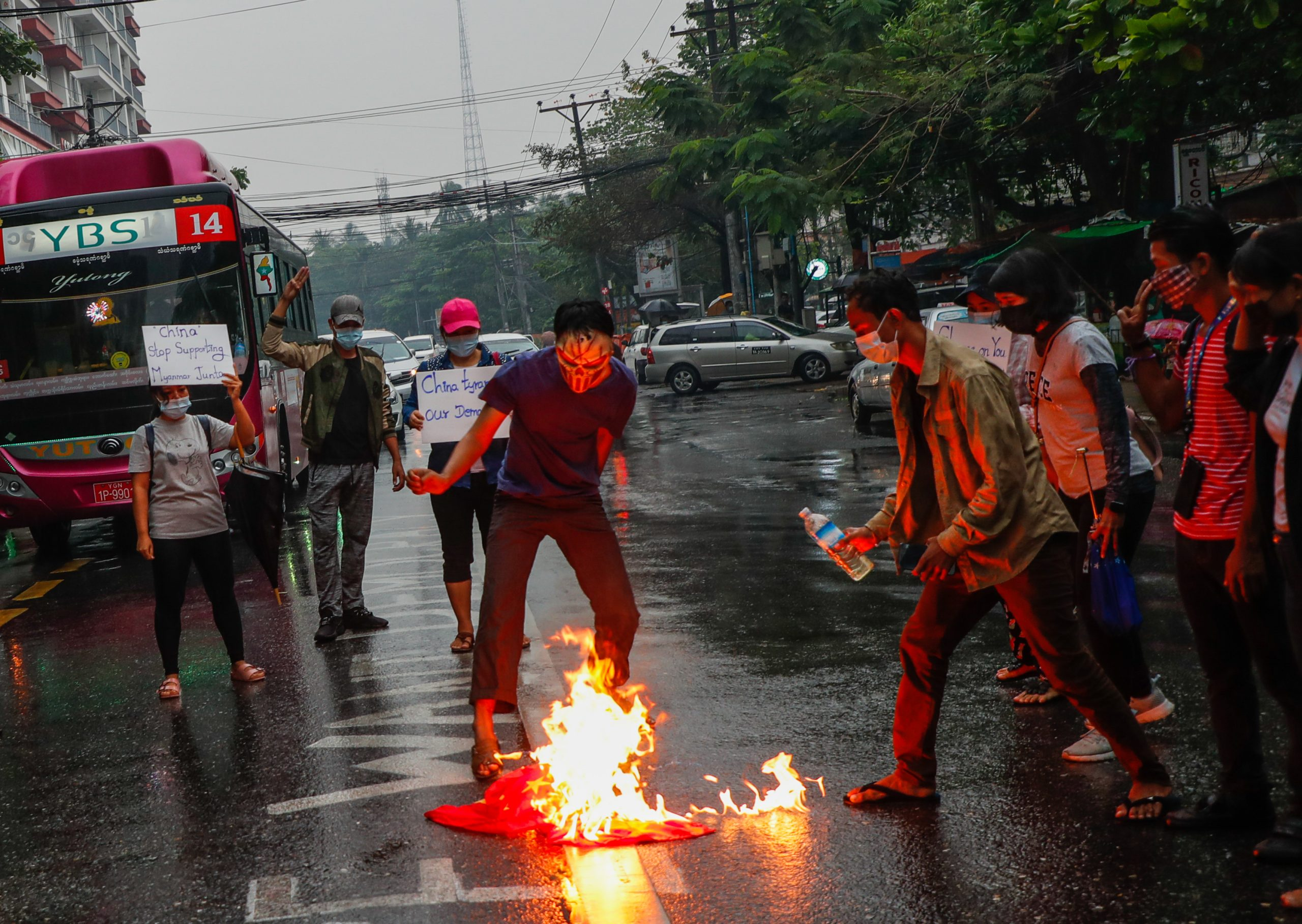 Protesters burn a Chinese flag in Yangon to show their anger at its response to the military coup. (Frontier)