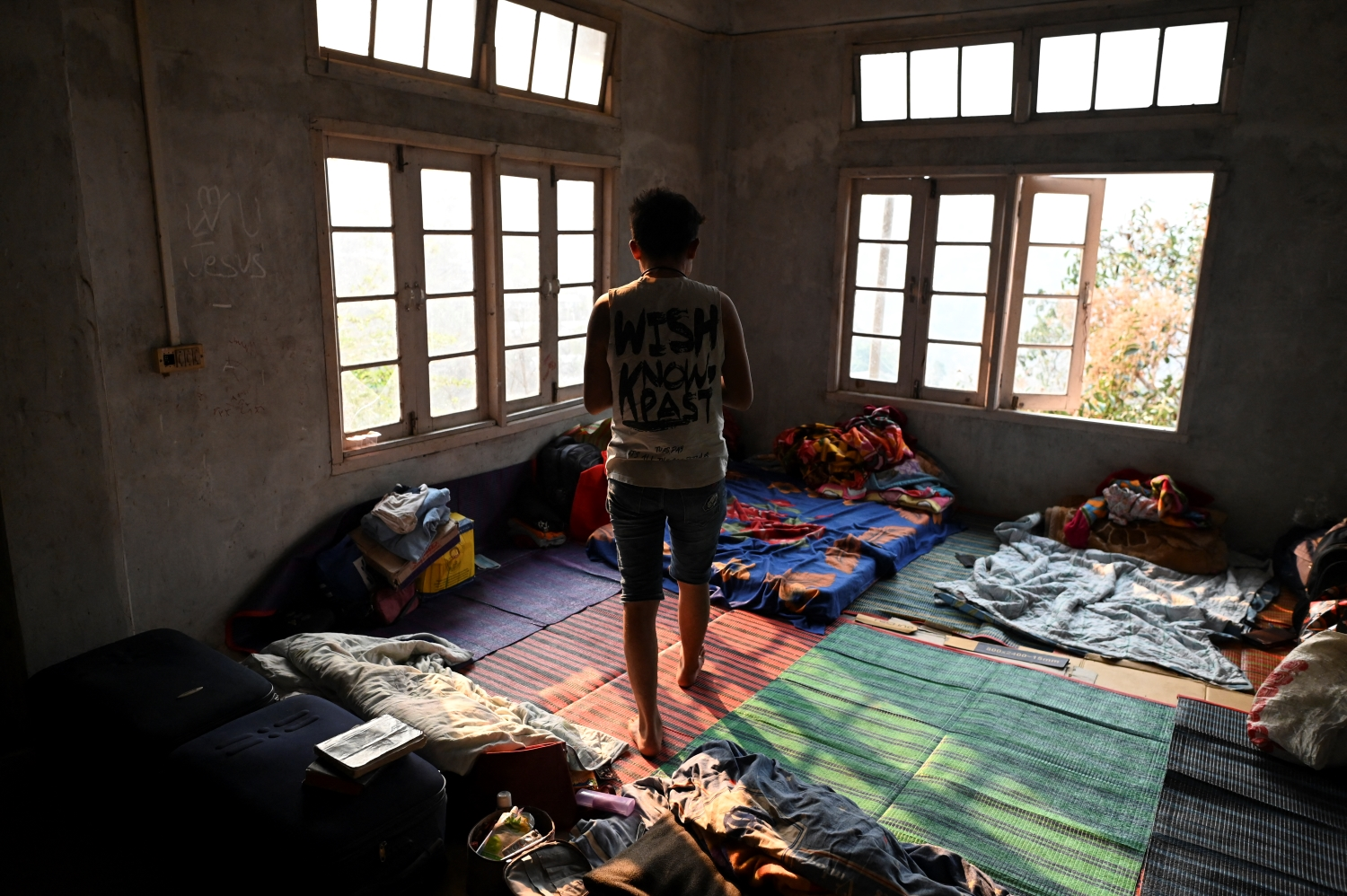 A police officer who fled Myanmar stands in a temporary shelter at an undisclosed location in India's northeastern state of Mizoram on March 13. Mizoram officials said in mid-March the state was harbouring at least 383 Myanmar public servants who had deserted their posts, of whom 98 percent claimed to be from the police and fire service. (AFP)