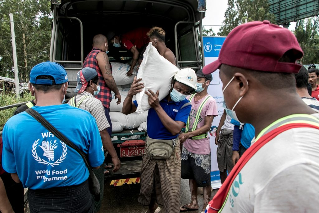 Poor residents of a Yangon suburb receive bags of rice from the World Food Programme on May 21. (AFP)