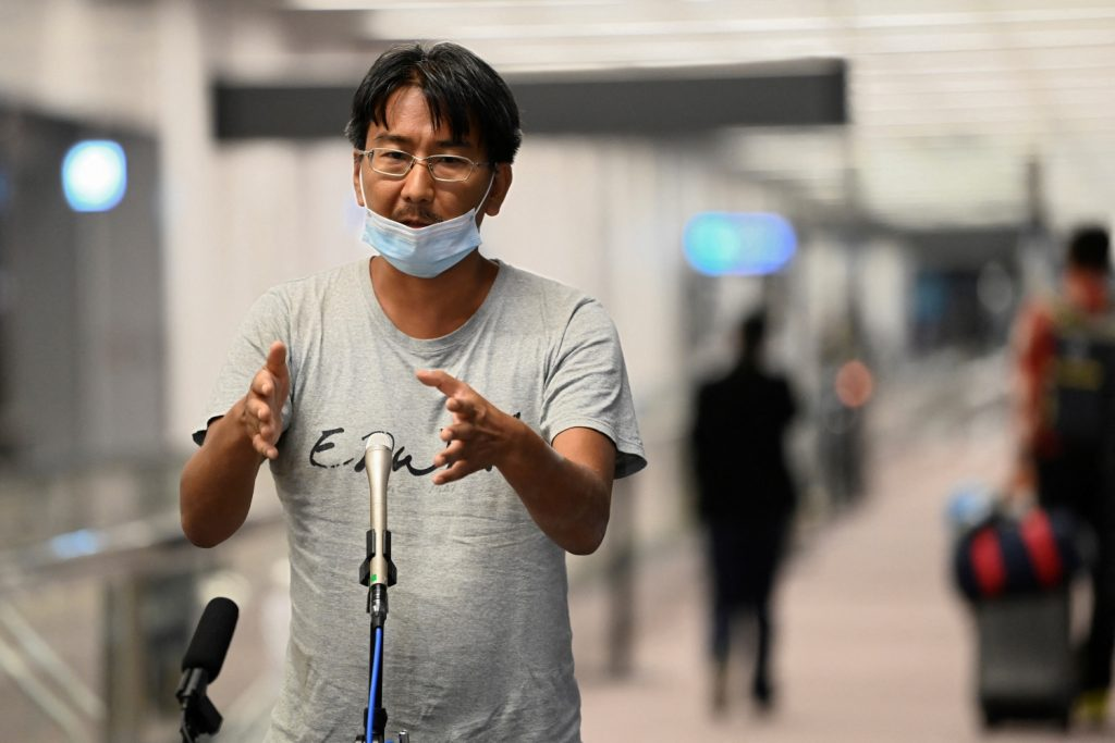Deported Japanese journalist Yuki Kitazumi, who was arrested last month in Myanmar and held in Yangon's Insein Prison for his coverage of the anti-junta uprising, speaks to the media after arriving at Tokyo's Narita Airport on May 14. (AFP)