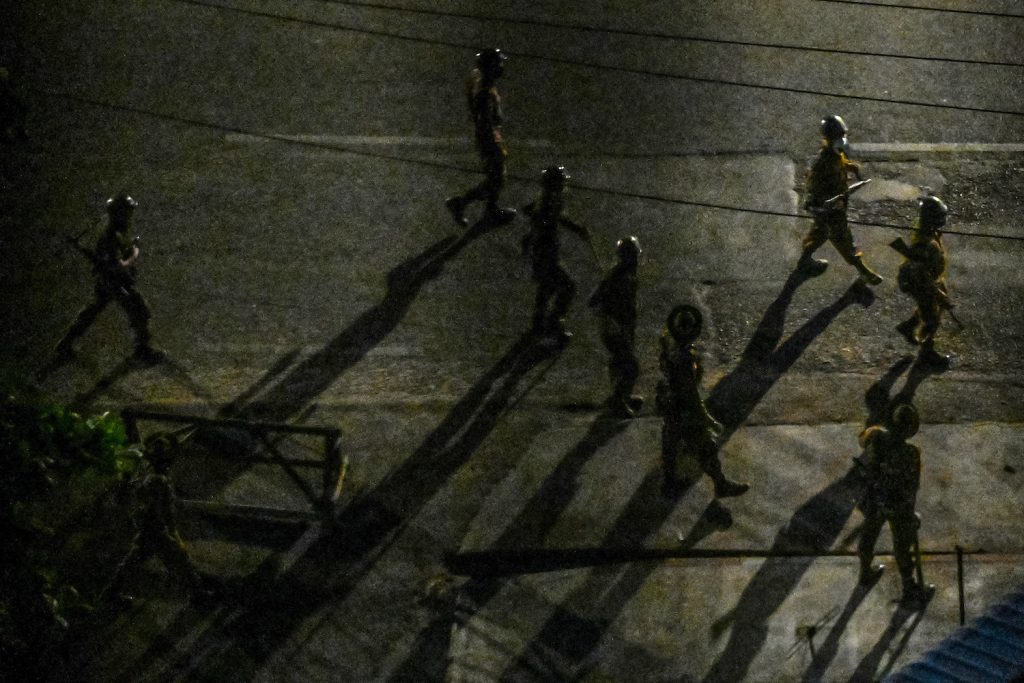 Soldiers patrol along a street in Yangon on April 2. (Frontier)