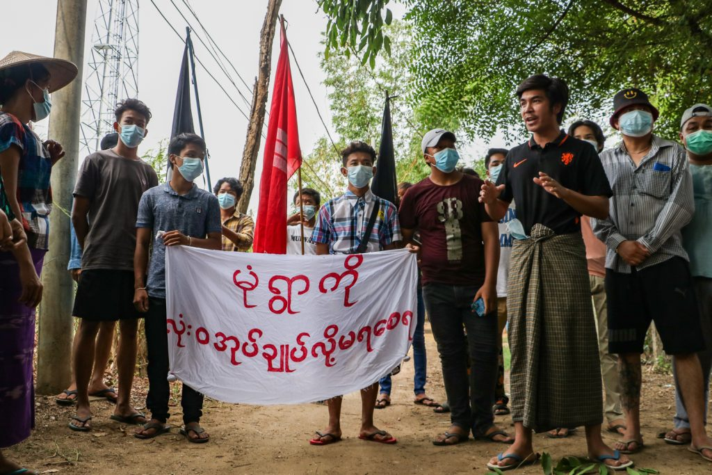 """Participants in a flash protest in Monywa on May 4 hold a banner that reads, """"No one can govern Monywa at all!"""" Monywa is one of the few towns that still has near-daily protests against the military regime. (Frontier)"""