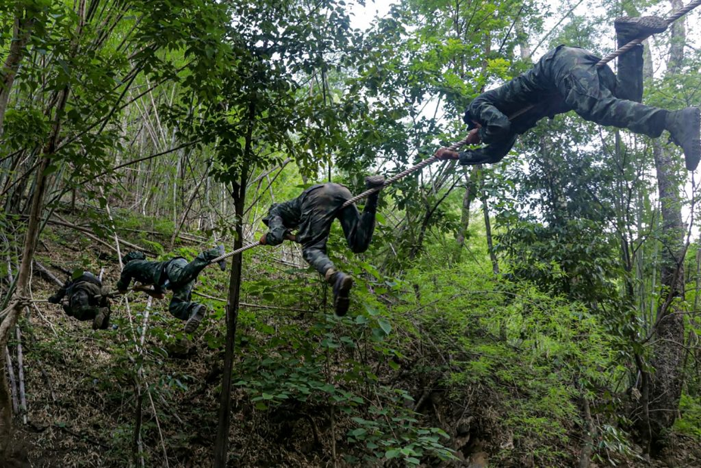 Anti-coup activists, many of whom come from Myanmar's cities, undergo basic military training in KNU territory in the jungles of Kayin State bordering Thailand. (AFP)