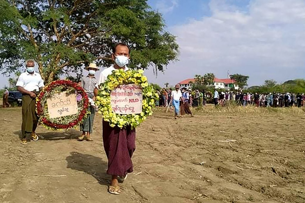 Mourners hold wreaths during the poet Khet Thi's May 10 funeral in Sagaing Region. (Facebook / AFP)