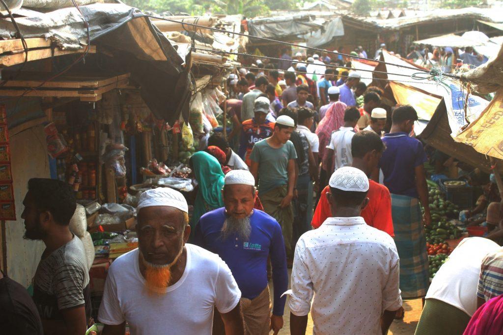 Rohingya refugees walk through a market inside a refugee camp in Ukhia, Bangladesh on April 6. (AFP)